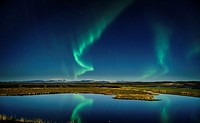 Northern lights with moonlight over the Skafta river, near Kirkjubaejarklaustur village, Iceland.