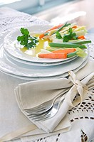 Preparation and presentation of mixed vegetables for garnish.