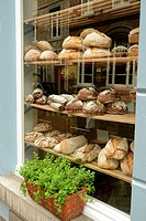 Window of artinasal bakery shop in Maastricht, Limburg, the Netherlands. Here, in addition to bread you can buy locally made cheeses, hand made lemon ...