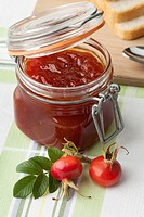 Jam with rose hips in a jar.