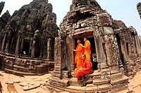 Buddhist monks at Bayon temple, Angkor thom, UNESCO World Heritage Site, Siem Reap