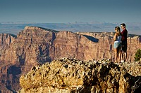 Tourists overlooking cliffs at Lipan Point, South Rim, Grand Canyon National Park, Arizona.