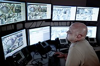 Video surveillance, control room with monitor wall.