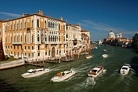 View of boats on the Grand Canal from Ponte dell´Accademia bridge with Palazzo Cavalli-Franchetti in the foreground and Santa Maria della Salute in th...