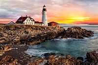 Portland Lighthouse Sunrise - The sun rises in Portland Head Lighthouse in Portland, Maine.