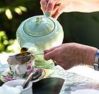 Pouring tea at Ludham village tearoom. Norfolk broads England UK.
