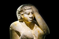 Egypt, Alexandria, National Museum, model statuette of a servant cooking and protecting his head from fire.