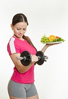 Young beautiful girl athlete Europeans conducting physical training, and promotes healthy eating.