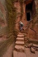 Woman on stairs at Bet (or Biete) Ammanuel ( House of Emmanuel). Rock Hewn Churche of Lalibela. Ethiopia.