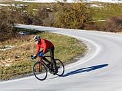 cyclist on a road. Lizarraga pass. Navarre, Spain.