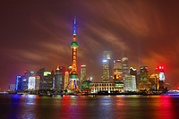 General view of the Pudong city skyline in Shanghai at night with the Oriental Pearl TV Tower, Shanghai, China.