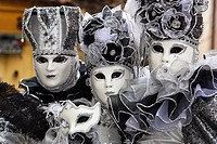 The traditional Venice carnival where carnival-goers dress up in fine costumes and masks.