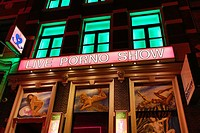 Live porno show in the Red Light District famous for prostitutes and prostitution in Amsterdam, Holland.