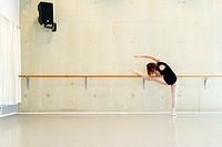 Arnhem, Netherlands. Young brunette ballet dancer training and rehearsing classical ballet in her ballet studio.