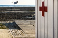 A white wall first aid in Playa Lisa beach, Alicante province, Spain