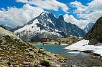 At the mountain lake Lac Blanc in the Aiguilles Rouges National Nature Reserve, peak Aiguille Verte and Les Drus behind, Chamonix, Haute-Savoie depart...