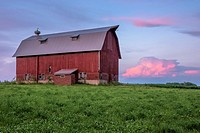 Red barn at sunset.
