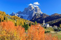 Autumn colors framing a tiny village in the Belluno Dolomites Selva di Cadore, Veneto, Italy Europe.