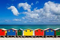 Landscape photo of the famous colourful Muizenberg beach huts on a perfect spring day. Muizenberg beach, Cape Town, South Africa.
