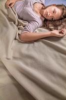 Teenage girl on her bed.