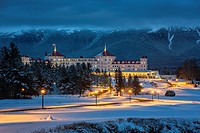 Mount Washington Hotel covered in snow at Twilight, Bretton Woods, New Hampshire.