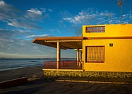 A yellow side house in Playa Lisa beach, Alicante coast, Spain