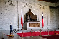 Taipei, Taiwan - The Statue of Chiang-Kai-Shek and the flag of Republic of China in the CKS Memorial Hall.