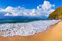 Sand and surf at Hanakapi´ai Beach along the Kalalau Trail, Na Pali Coast, Island of Kauai, Hawaii.