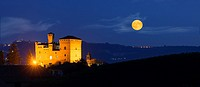 View in the night with a full moon on the Castle of Grinzane Cavour Unesco heritage in the territory of the Langhe Piedmont Italy.