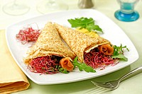 Crepes with sprouts and salmon.