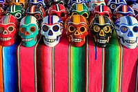 Porcelain skulls decorated in American footbal colours, set out as part of the Day of the Dead, Puerto Vallarta, Mexico.