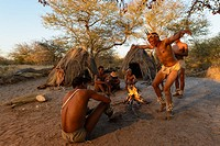 San or Bushman men dancing around a fire. Haina Kalahari Lodge. Botswana.