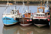 Fishing trawlers in the harbour, Bridlington, East Yorkshire, England, UK.