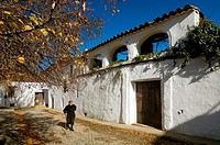 Muñiz Pablo square and old woman, Castaño del Robledo, Huelva province, Region of Andalusia, Spain, Europe.