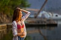Beautiful teen girl in bikini and White shirt hand on tummy