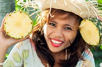 Young Asian woman with pineapple, on location, Cebu, Philippines