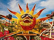 Portion of a 2016 Rose Parade float showing a sunburst and various other Los Angeles attractions presented by the city of Los Angeles. Pasadena, Cali...