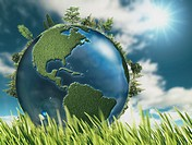Eco natural backgrounds with Earth globe and green grass.
