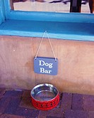 water bowl on sidewalk for passing dogs on a hot day. Santa Fe, New Mexico.
