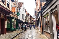 Tourists walking along the Shambles, York, North Yorkshire, England, United Kingdom.