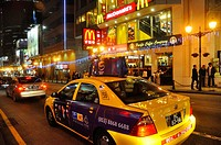 Asia, China, Macao, taxis and Mc Donald´s in the city center at night ...