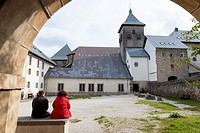 Pilgrims resting in the courtyard of the Albergue de Roncesvalles - Navarre, Spain. The albergue is run by the Dutch Society of St. James.