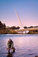 Fisherman in front of the Sundial Bridge on the Sacramento River, Redding, California.
