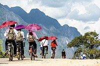 Asia. South-East Asia. Laos. Province of Vang Vieng. Children leaving school by bicycle.