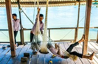 Asia. South-East Asia. Laos. Province of Champassak. 4000 islands. Don Khon. Boys playing near Mekong river.