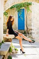 Long-legged young woman sunbathe