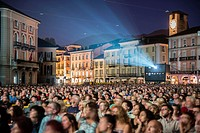 Film Festival Locarno with crowd and projector on piazza Grande in Ticino, Switzerland.