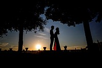 Silhouette couple at sunset.