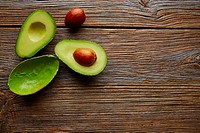 avocado cut on aged wood table board cutted half.