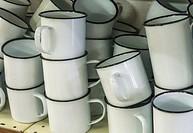 Old-fashioned white, enamel mugs.